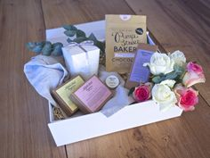 Luxury hamper filled with the finest natural skincare products, artisan chocolate and soy wax candle. A thoughtful Valentine's, Birthday or Mother's Day gift.