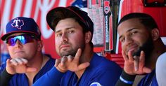 TEMPE, AZ - MARCH 13: Joey Gallo #13 (C) and Nomar Mazara #30 (R) of the Texas Rangers of the Texas Rangers gesture to the camera during the spring training game against the Los Angeles Angels at Tempe Diablo Stadium on March 13, 2016 in Tempe, Arizona. (Photo by Jennifer Stewart/Getty Images)