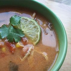 Slow-Cooker Chicken Tortilla Soup Allrecipes.com - serve with lime juice, a tsp of sour cream, chopped avocados, or pork rind along with the cheese to really eat it like a Mexican. Can use bagged tortilla chips and worked fine.