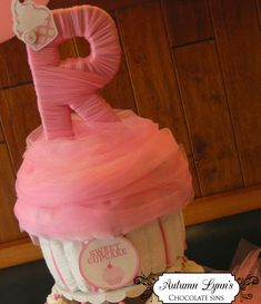 Baby shower ideas- Diaper cupcake! How cute