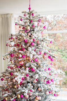 Snow sprayed white flocked tree with pink and green balls, and white snowflakes would be cute, with red or yellow lights.