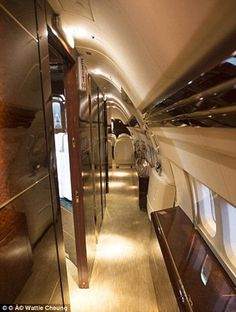 The Trump family jet boasts impressive gold accents, a double bed, a large lounge, and a m...
