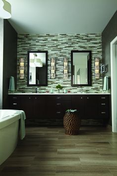 Awesome double vanity in the master bath with a tiled back wall and Fredrick Ramond Mira sconces in polished chrome.