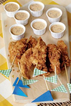 Jalapeño-Mustard Dipping Sauce - Super Dips for Bowl Games - Southernliving. Recipe:Jalapeño-Mustard Dipping Sauce  Just before the game, stop by a grocer's deli counter or the drive-through of your favorite restaurant for fresh, hot chicken tenders and serve with this homemade dipping sauce. Make them festive with team spirit skewers. Simply cut flags from scrapbook paper in the shape of pennants, and tape them to wooden skewers.