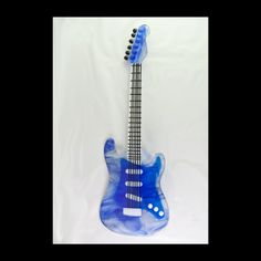 20 inch Transparent Blue Electric Guitar in Fused Glass. $250.00, via Etsy.