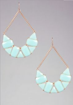 Ocean-hued geometric half moon earrings that feature a sexy dropdown swing-hang and a plated gold dipped back. Stunning with a strapless crop top.