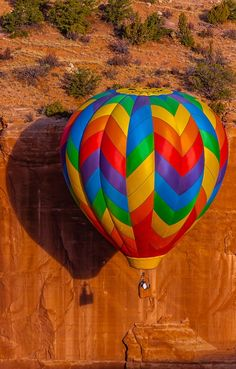 Aerial view of hot air balloon flying during the Red Rock Balloon Rally, Red Rock State Park, near Gallup, New Mexico USA.