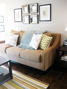 brown couch, grey wall, green/blue/white accents