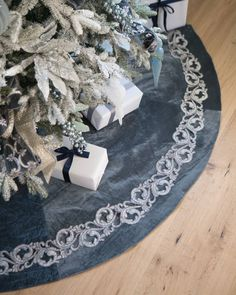 Give presents a plush and elegant backdrop with our French Blue Tree Skirt. Velvet fabric in a deep azure hue with glints of grey is accented by metallic acanthus appliqués for an opulent display with a hint of shine. #BalsamHillUK #ChristmasDecor #ChristmasTree #ChristmasIdeas #ChristmasStocking #ChristmasDesign #HomeDecor #Interior #InteriorDesign #Home #Design #Fall #Autumn #Inspiration #Wreath #Garland
