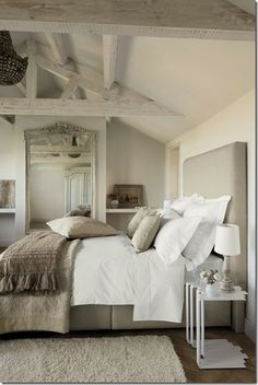 Whitewashed beams on the ceiling and texture in the bedlinens and area rug create a gorgeous neutral bedroom. DIY the chandelier!