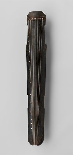 The Qin (Zither)  The qin is the classical instrument of China. Its origin is obscure. The present form, with seven unfretted strings, probably emerged only in the late Han period (1st century A.D.), although, according to legend, it is supposed to have been played in the time of Confucius (6th century B.C.) or even earlier.