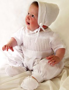 A very smart boys christening romper heirloom piece that speaks comfortably today of days before yesterday.