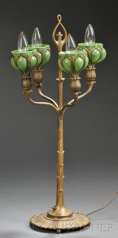 ART NOUVEAU CANDELABRA TABLE LAMP BRONZE AND ART GLASS EARLY 20TH CENTURY CYLINDRICAL STANDARD IN THE FORM OF A LEAFY STEM WITH FOUR... - 20TH CENTURY FURNITURE & DECORATIVE ARTS - SALE 2531B - LOT 269 - Skinner Inc