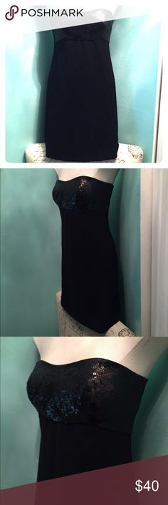 Ann Taylor sequin top strapless dress Ann Taylor Petite black strapless dress with a sequin bust and hidden back zipper with hook eye enclosure. Gorgeous dress! Worn once!! *For a limited time- Everything in my closet is Buy 1 Get 1 FREE!!! (Equal or lesser value) ❤️ Ann Taylor Dresses