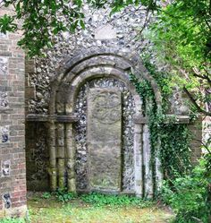 Blocked off late Anglo Saxon doorway (tombstone inset) at St John sub Castro, Lewes