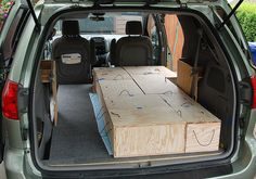 "Lots of photos of how this guy sets up his minivan to be a ""bedroom"" for travel!"
