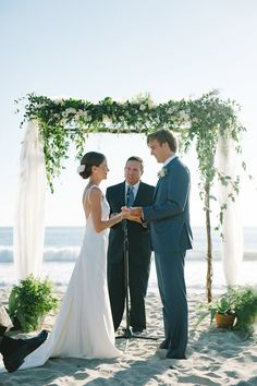 Couple at Ceremony with Ocean View   Photo: John Schnack Photography. View More: https://www.insideweddings.com/weddings/sweet-simple-beach-wedding-with-wood-detailing-in-california/870/