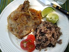Cuban pork chops with a side of beans and rice, garnished with fresh tomato and lime wedges Cuban Recipes, Pork Chop Recipes, Vegetarian Recipes, Cooking Recipes, Colombian Recipes, Healthy Cooking, Healthy Foods, Healthy Eating, Healthy Recipes