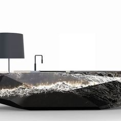 QuartzRock is a hit at #EspacioCocina in Feria Valencia! Our latest creation in partnership with @Arik_levy is 3.80 m. long, weighs 850 kg., and is made up of 29 slabs of our Ice Black quartz. An impressive piece to make a bold statement.  #QuartzRock #Homedesign #interiordesign #interiorismo #style #stylist #decor #homedecor #IceBlack #kitchen #cocina #cuarzo #quartz #IceBlack #COMPACsurfaces #superficiesCOMPAC #bathrooms #baños #homeImprovement #inspiration #homeInspo #COMPAC