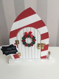 Beautiful magical red and white candy cane elf doors by TheLittlehCompany buy now from https://www.etsy.com/uk/shop/TheLittlehCompany