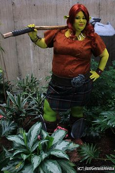Candy of Sweets4aSweetCosplay as the warrior Fiona from Shrek Forever After. She made the costume and props herself, but the best part may b...