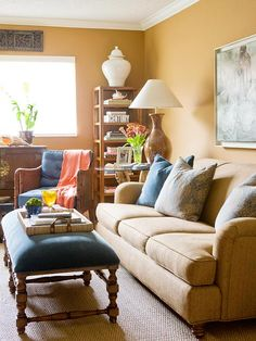 Shades of Brown  Brown is the go-to neutral for the fall season. It can sway gray for a crisp look, or it can veer into yellow for a cozy look. Here, butterscotch-brown walls envelop the room in a comfy sheath of color. The yellow-tinted hue coordinates with the oatmeal-color sofa and contrasts the sapphire accents.