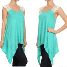 Asymmetrical hem top Asymmetrical hem top. Made in USA. Round neckline, lace detail. 95% rayon, 5% spandex. Tops