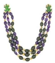 Tony Duquette (American, 1914-1999), 1990s. A green amber and amethyst bead and vermeil necklace with painted metal 'frog' clasp, length 19in (48.2cm). Sold for $1,708