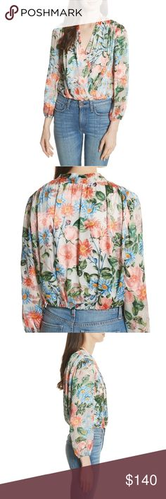 76abef15e872c ALICE + OLIVIA Women Trista Blouson Wrap Top That just-right length is  achieved in