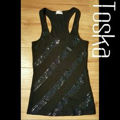 Black Sequin Striped tank top SMALL NWOT Toska Brand cute black iridescent sequin striped black ribbed tank top  Back of tank is plain black without sequins  size small  Poly/cotton/ spandex  Hand wash cold inside out   Never worn- NWOT toska Tops Tank Tops