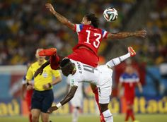 Jermaine Jones (13) of the U.S. jumps for the ball against Ghana's Daniel Opare during their 2014 World Cup Group G soccer match at the Dunas arena in Natal June 16, 2014.