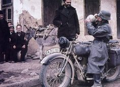 A dispatch motorcyclist stopping for a water break