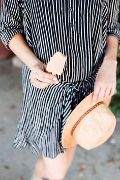 navy and white striped wrap dress with the knot in the front and a straw fedora // spring style