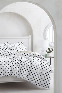 arched entryways & dotted bedding- perfect for a girl's room