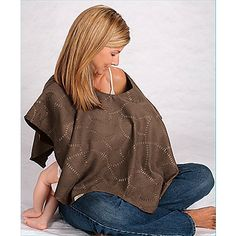 Breast Feeding Nursing Shawl. These might look great and all but if your baby isn't use to it, good luck getting him/ her to stay under there. After a while you just give up on caring, cuz it's so natural babies need to eat and drink too. Ppl should just get over it If you in public with your boob out lol!!!!