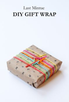 Wrap in stamped brown paper and tie with coloured yarn