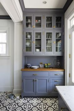 Clean lines, open shelf cabinets, and bright light keep this storage corner from looking drab.