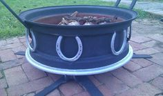 Fire pit made out of a tractor hub, farming chisels, and horse shoes.