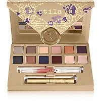 Stila - Trust In Love Giftable Set $28 (Hoiday 2015). Set inludes 12 color-rich matte, pearl and shimmer eye shadows, a deluxe-size HUGE™ Extreme Lash Mascara for thick, flirty lashes, and a deluxe-size Lip Glaze in Apricot.  Eye Shadow Shades: Warm Silver, Fog, Nude Shimmer, Clay, Golden Topaz, Plum, Black Pearl, Stone, Sapphire, Metallic Bronze, Snowflake,and Light Pink