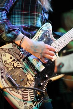 Doodling on a guitar is always a great way to have a cool look.