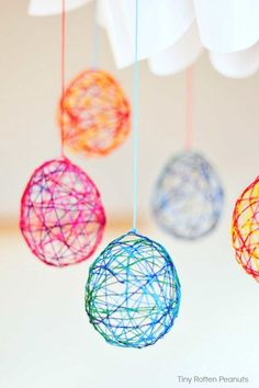 String Easter Eggs: After making these together, hang these pretty yarn eggs in your kids' rooms so they can have their very own Easter decoration.Click through to find more simple, easy and fun Easter crafts to make with your kids.