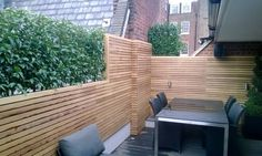 Slatted panels around an outside dining area