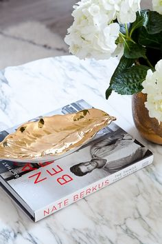 Cocktail table decor: http://www.stylemepretty.com/living/2015/02/19/the-most-fashionable-coffee-table-books/
