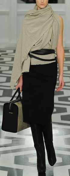 From the Victoria Beckham collection. Ecru shawl/cape/sweater w/ black skirt and Black Wraparound belt. I DO LOVE THIS KIND OF STUFF! Stasia