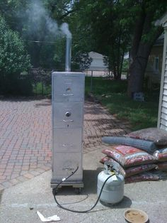 Recipe: 1 old-ass, four-drawer filing cabinet (no plastic parts… Build A Smoker, Bbq Pit Smoker, Barrel Smoker, Diy Smoker, Homemade Smoker, Propane Smokers, Meat Smokers, Smoking Pit, Grill Rack