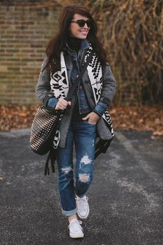 Sydney layering a denim jacket with a Zara coat and printed vest. I love the Converse sneakers and studded Nasty Gal bag