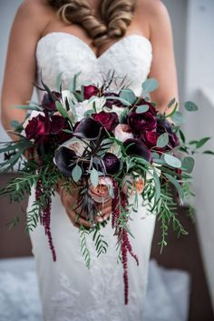 Dark-Colored Bridal Bouquet Photography: Kim Fox Photography Read More: http://www.insideweddings.com/weddings/luxe-vintage-inspired-winter-wedding-in-downtown-los-angeles/1082/ #weddingbouquets