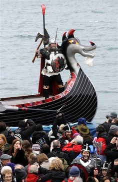 'Guizer Jarl' David Nicholson, leader of the 'Jarl Squad', stands aboard his longboat next to its beast-head prow during the annual Up Helly Aa festival in Lerwick, Shetland Islands on Jan. 31. Up Helly Aa celebrates the influence of the Scandinavian Vikings in the Shetland Islands and culminates with up to 1,000 'guizers' (men in costume) throwing flaming torches into their Viking longboat and setting it alight later in the evening.