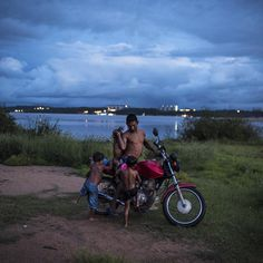 "Hello everyone! It's @avelkaim here taking over the Instagram feed for the week. I just got back from the Brazilian Amazon working on my project ""Where the River Runs Through"" which explores The Amazon Dam Boom and is now supported by the Alexia Foundation. I'll be sharing some of the new work. So enjoy. -A Munduruku father from the village of Larangao is seen with his children after bathing in the Tapajos River near the city of Itaituba. The river where over 13000 Munduruku live has been…"