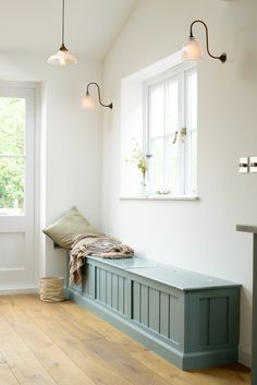 The perfect place to sit and chill; a beautiful bench seat by deVOL Kitchens